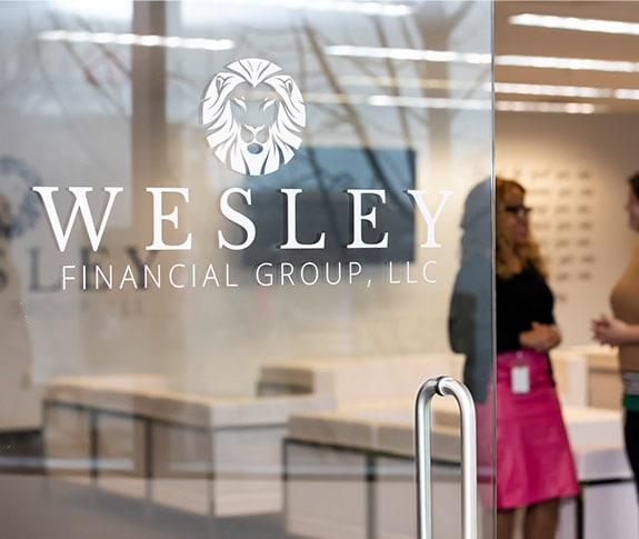 wesley financial logo on glass door